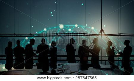Silhouetted business people meeting in a boardroom