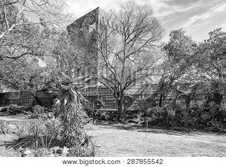 Pretoria, South Africa, July 31, 2018: An Aloe And Trees Next To The Laager Of 64 Granite Ox-wagons