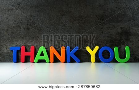 Thank You Sign And Word On Colorful Letters For Thanks Giving Message To Customers On Dark Grunge Ba