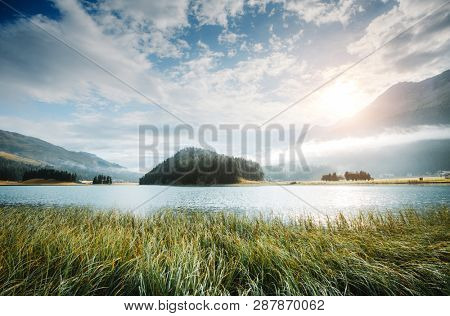 Beautiful alpine lake Champfer in beautiful summer day. Location place Silvaplana village, Swiss alps, district of Maloja, Europe. Scenic image of famous european resort. Discover the beauty of earth.