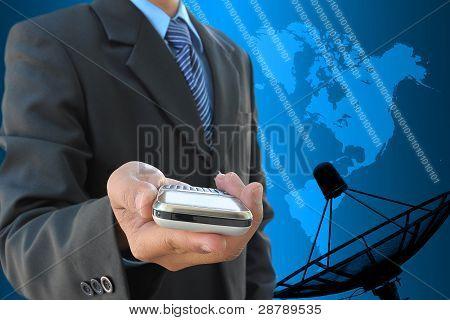 businessman hand holding mobile phone and satellite dish antennas