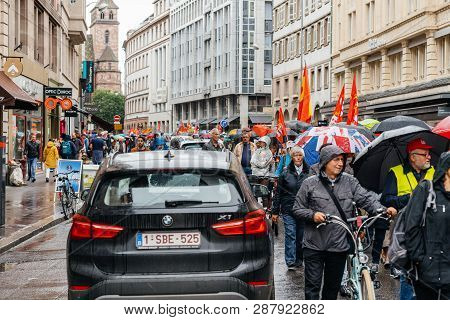 Strasbourg, France - Sep 12, 2017: Crowd Marching Under Rain Political March During A French Nationw
