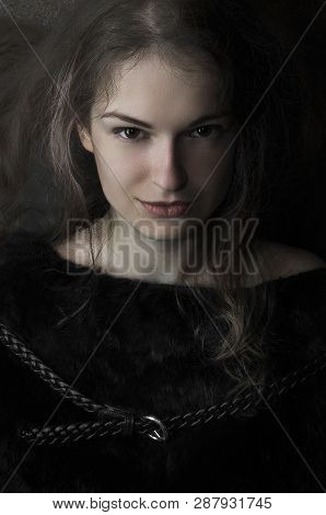 Portrait Of The Evil Witch Woman In The Dark Room