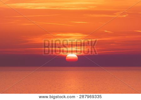 Sunset Over The Sea Horizon Nature Landscape. Red Clouds And Sea Landscape. Sea Nature In Sunset. Na