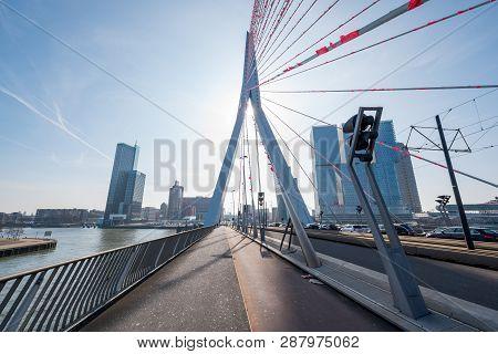 Rotterdam, Netherlands - March 26, 2016 : Erasmus Bridge Against Blue Sky And Sun