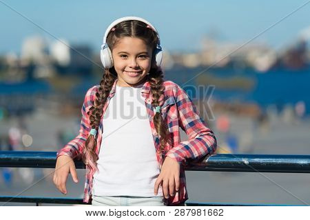 Inspired By Music. Little Kid Listening To Music. Cute Kid With Wireless Headset. Small Kid Wearing