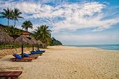 Sand tropic palms and sunbeds. Best Kuantan beach resorts. Luxury vacation at crystal clear waters and pristine beaches. Beach resorts rank as some of best in region. Tropic paradise at seaside. poster