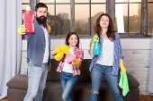 We love cleanliness and tidiness. Cleaning together easier and more fun. Family care about cleanliness. Start cleaning. Cleaning day. Family mom dad and daughter with cleaning supplies at living room. poster