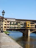 The Ponte Vecchio /Old Bridge/ is a Medieval bridge over the Arno River in Florence Italy poster