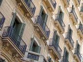 Geometric shapes on the facade of a modernist residential building - Barcelona, Catalonia, Spain poster