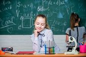 Microscope test tubes chemical reactions. Pupils at chalkboard. Fascinating science. Formal education school. Educational experiment. Back to school. School classes. Girls study chemistry in school poster