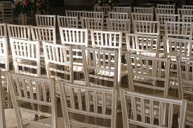 A View Of Rows Of Empty White Chairs Arranged For An Event Or A Celebration