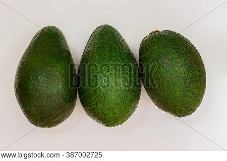 Three Avocado On A White Background. Avocado Macro. Close Up Of An Avacado. Avocado Isolated On Whit