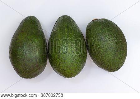 Three Avocado On A White Background. Avocado Macro. Close Up Avacado. Avocado Isolated On White Back