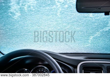 The View From The Inside Of The Car To The Frozen Glass. Frozen Windshield Of The Car. Car Window Un