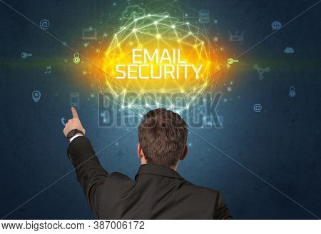 Rear view of a businessman with EMAIL SECURITY inscription, online security concept