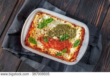 Lasagne Topped With Tomato Sauce And Pesto
