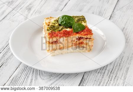 Portion Of Lasagne On White Plate