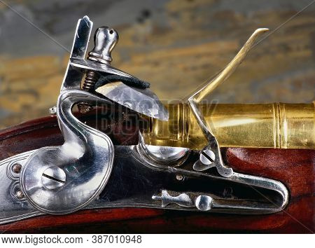 Closeup Of Antique Flintlock Gun Showing The Hammer ,flint , Pan And Frizzen.