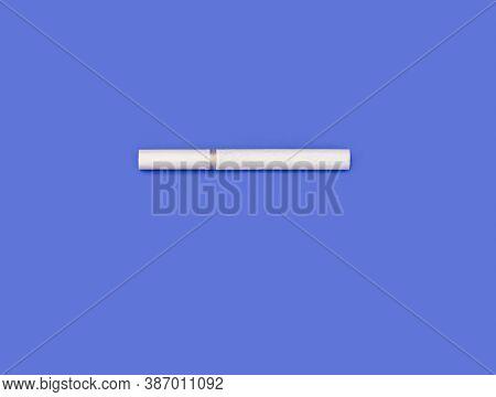 White Cigarette On Blue Background. Cigarette For Smoking On Blue Background. Dependence