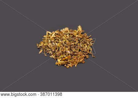 Tobacco On Greybackground. Dry Tobacco Leaves. Cigarette Tobacco On Grey Background. Dry Tobacco For