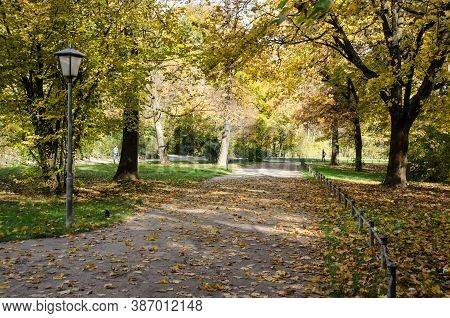 Walking Path In The English Park. There Are A Lot Of Parks In Munich. The English Park Is The Most B