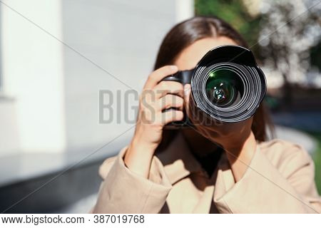 Private Detective With Camera Spying On City Street