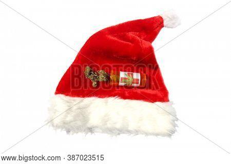 Santa Claus Hat with Marijuana. Isolated on white. Room for text. Marijuana Buds on a Santa Hat.