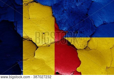 Flags Of Romania And Ukraine Painted On Cracked Wall