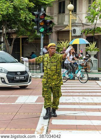 George Town, Penang, Malaysia - December 1, 2019: Street Traffic Warden Is Working At Intersection I