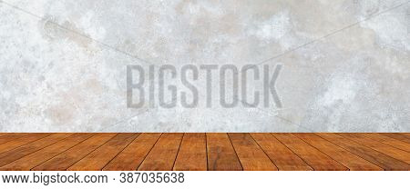 Wooden Shelf With Raw Old Cement Concrete Or Plaster Wall With Stains And Cracks For Background And