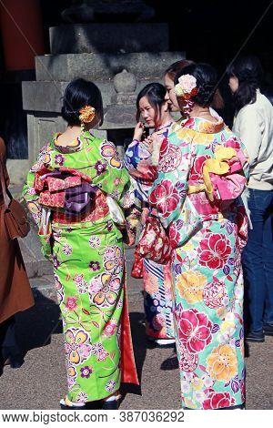 Fushimi-ku, Kyoto, Japan, November 17, 2017 : Behind Of Three Japanese Woman In Kimono Dress At Fush