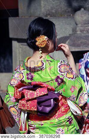 Fushimi-ku, Kyoto, Japan, November 17, 2017 : Behind Of Japanese Woman In Kimono Dress At Fushimi In