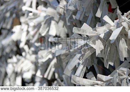 Fushimi-ku, Kyoto, Japan, November 17, 2017 : Bad Luck Of White Predict Fortune Paper Tied Together