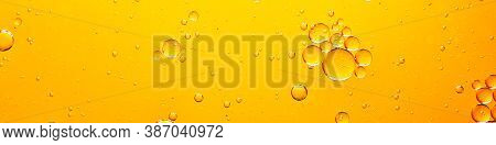 Oil With Bubbles On Coral Background. Orange Abstract Space Background. Soft Selective Focus. Macro