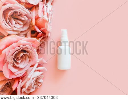 Mockup Of Unbranded White Plastic Spray Bottle And Pink Roses On A Pastel Pink Background. Bottle Fo