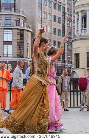 Hare Krishna Followers. Hare Krishna Girls In Beautiful Saree Dresses Dancing On The Street Sept.202