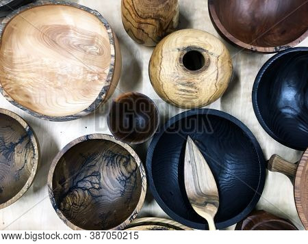 Empty Wooden Bowl On White Linen Fabric. Top View Of Wooden Bowl On Weathered Background. Close Up T
