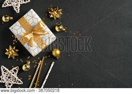 Dark Christmas Background With Luxury Gift Box, Golden Decorations, Glitter Confetti. Christmas, Win