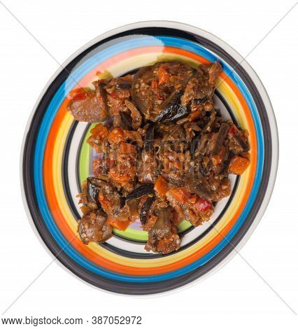 Stewed Zucchini With Tomatoes And Peppers On White Black Blue Red Yellw Plate Isolated On A White Ba