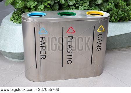Stainless Steel Trash Placed In Public Areas Color Separation In Littering (concept Of Waste Separat