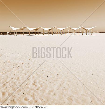 Sunshade On The Beach Of Mediterranean Sea In Israel, Vintage Style Sepia