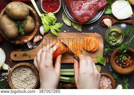 Womens Hands Cut Carrots. Cooking Food Background. Fresh Organic Vegetables, Ingredients, Spices And