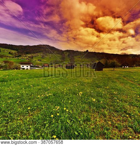 The Green Pastures In Switzerland At Sunset