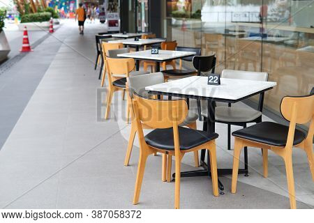 Chair And Dining Table Prepared In The Area Beside The Restaurant For Serving Walkway Area