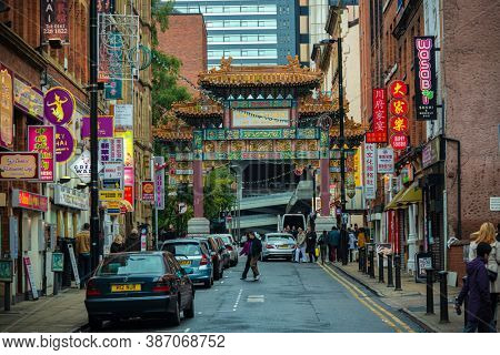 MANCHESTER, UK - FEB 24, 2020: Chinatown street view with stores in Manchester, England, United Kingdom