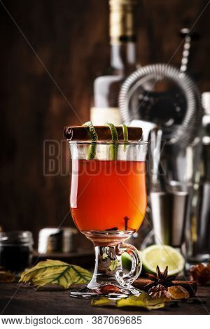Hot Rum Punch, Grog, Autumn Or Winter Warming Alcoholic Cocktail With Dark Rum, Port, Honey, Lime Ju