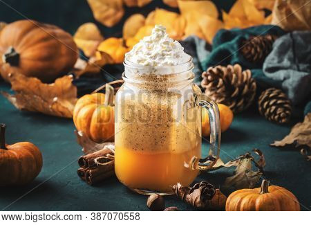 Pumpkin Spiced Latte Or Coffee In Glass Jar On Blue Table. Autumn Or Winter Hot Drink In Festive Nat