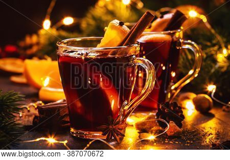 Christmas Mulled Red Wine With Spices And Fruits On Wooden Rustic Table. Traditional Christmas Or Ne