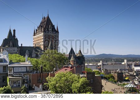 The Historic Chateau Frontenac Above The Quebec Port On A Cloudless Sunny Day In Canada.